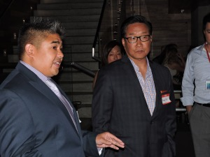Michael Kim (right) listens during a Sports Task Force event at the Asian American Journalist Association convention in San Francisco. Kim is joined by ESPN's New York Knicks and Brooklyn Nets writer Ohm Youngmisuk.